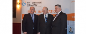 Ireland's Minister For Finance Michael Noonan is flanked by DNM executives Malachy Smith and David Quirke