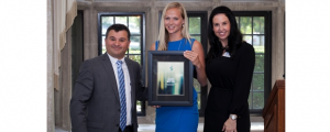 2014 Rising Star winner Laura Wittig is flanked by CDN Editor Paolo Del Nibletto and Ingram Micro's VP of Marketing Jennifer Johnson