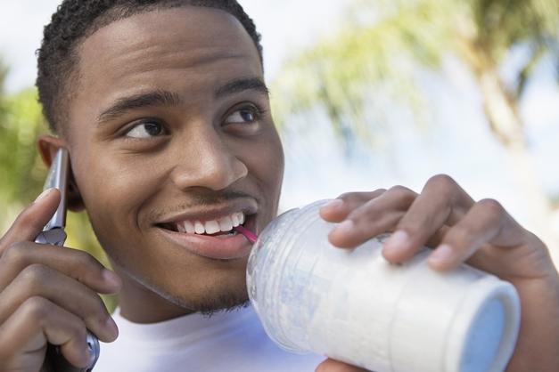 in story shutterstock milkshake and cellphone man