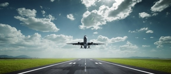 Plane taking off clouds runway