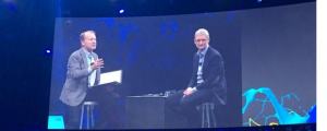 Cisco Chairman John Chambers with Apple CEO Tim Cook on stage at  GSX in Las Vegas
