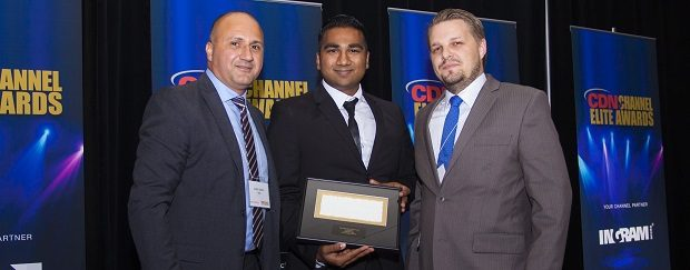 AMD Canada channel chief Hanif Mawji presents Best Enterprise Solution award to Kishan Latchman and Brian Henshaw of I3 Solutions