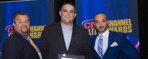 Joe Ussia and Chris Stock from Infinite IT Solutions is presented with the CEA award by Stefan Galloro of Rogers