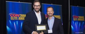 Michel St-Andre of Orckestra accepts the Best Cloud Solution award from Eric Bender of Rogers