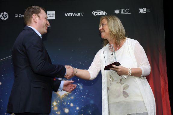 Deanna Thomsom shakes hands with Jason Mackay