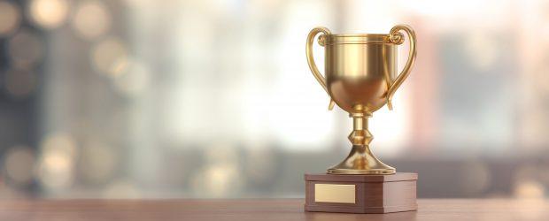 Gold Award Cup Against Defocused Background